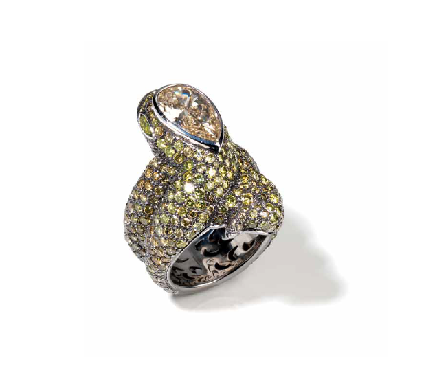 Cassetti snake ring set in white gold with fancy diamonds