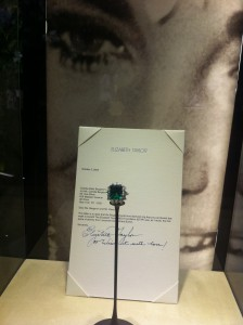 "Ring in platinum with emerald and diamonds, 1962. It was the first jewel that Elizabeth Taylor received from Richard Burton in Rome during the filming of Cleopatra. The actress sold it in 2002 at a charity auction for ""The Elisabeth Taylor AIDS Foundation"" and in a letter addressed to the new owners, Taylor wrote: ""Wear it with love!"". In the former collection of Elizabethe Taylor. Bulgari Heritage Collection."