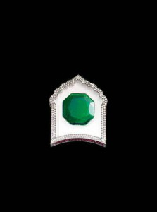 Brooch in gold, set with emerald, diamonds, rubies, rock crystal and white agate, JAR, 2002. The Al-Thani Collection.