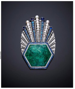 Ornament, Aigrette, Paul Iribe, Turban ornament with carved emerald of platinum, with a large hexagonal carved Indian emerald from 1850–1900, with millegrain-set diamonds and channel-set calibrécut sapphires. The Al Thani Collection