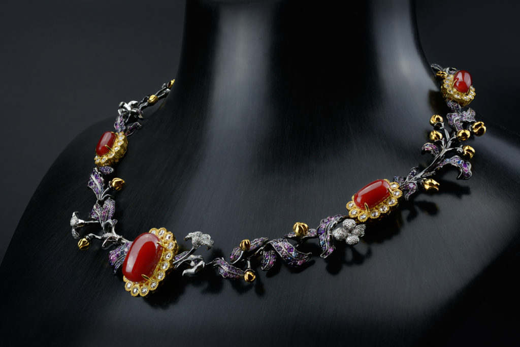 """The Botanic Garden Necklace"" made of white and blackened gold with corals, purple, blue, pink sapphires, white diamonds, Feng J."